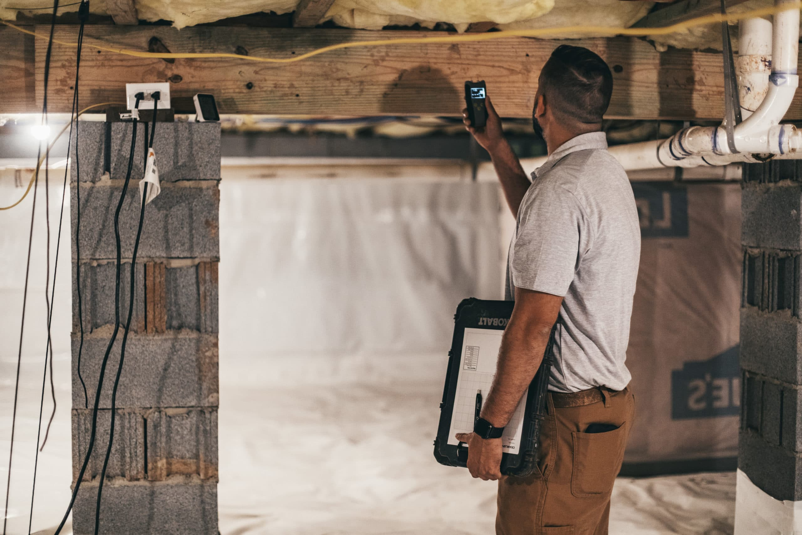 crawl space inspection being conducted before buying home