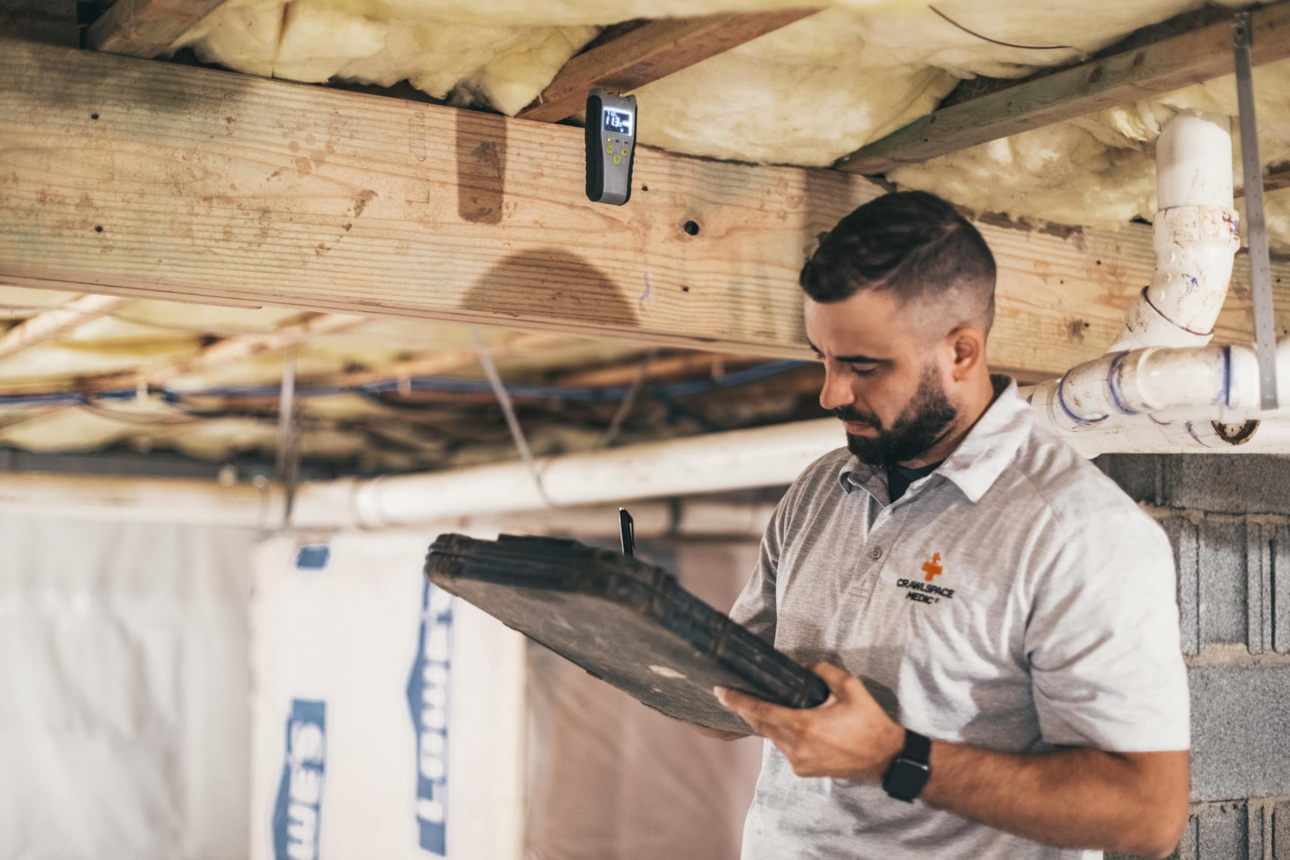 contractor conducting crawl space maintenance